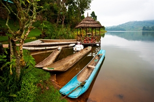 An exotic, hot non-specific destination with a brown river and some bright coloured boats.